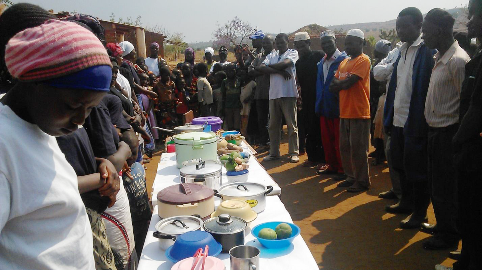Rural women from the community display food prepared during RLEEP nutrition training in Ntchisi, Malawi.